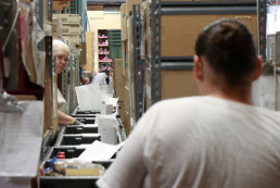 inmates fulfilling commissary orders placed on conveyor belts