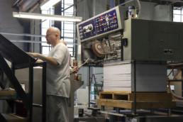 Inmate operating large print machinery