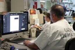 Inmates designing material using computers
