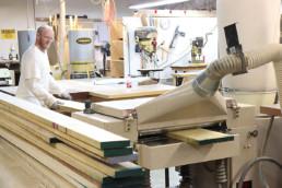 Inmate working on wood sanding machine
