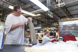 Inmates reupholstering seat covers