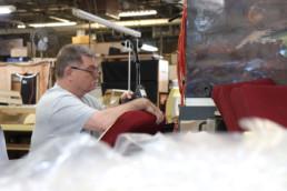 Inmate reupholstering seat cover