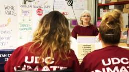 Female offender giving speech to fellow makin it work graduates